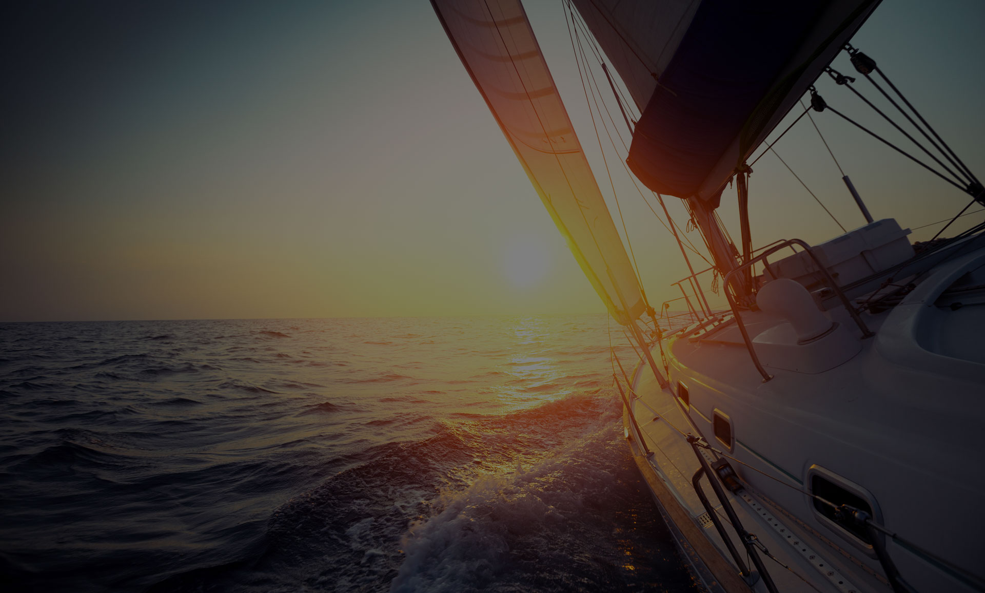 Sunset at the bow of a sailboat